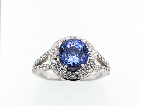 14 KARAT WHITE GOLD TANZANITE HALO RING by The Hunt House Custom Jewellery