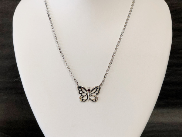 Sterling Silver Butterfly Ruby pendant by The Hunt House Custom Jewellery