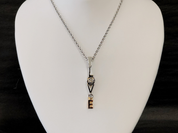 "Sterling Silver ""LOVE"" pendant by The Hunt House Custom Jewellery"